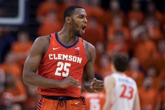 Feb 5, 2020; Charlottesville, Virginia, USA; Clemson Tigers forward Aamir Simms (25) reacts to a play against the Virginia Cavaliers during the second half at John Paul Jones Arena. Mandatory Credit: Scott Taetsch-USA TODAY Sports