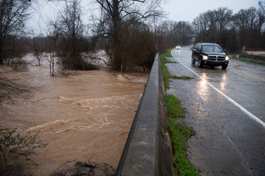 Water flows under Scuffletown Road in Simpsonville during a day of heavy rain Thursday, Feb. 06, 2020.