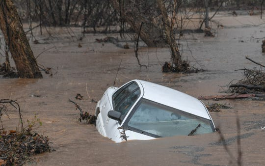 A car settled in the Rocky River off of Snow Road in Anderson Thursday, February 6, 2020. Firemen at the scene said the car had been parked on the side of the road and with heavy rain, slipped into the rising water from the river.