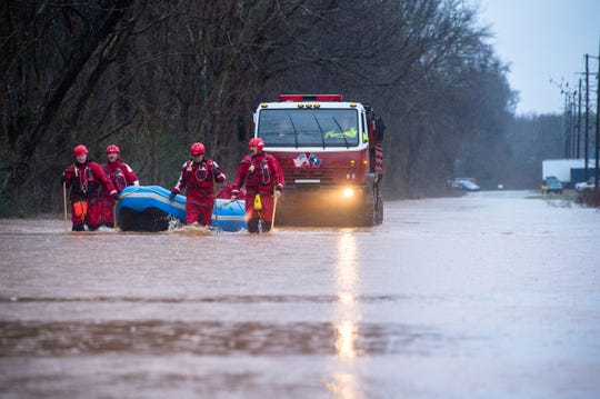 Berea firefighters make their way with a rescue truck through floodwaters carrying workers from Mosaic Color & Additives off of Sulphur Springs Road who were stranded Thursday, February 6, 2020 after heavy rain stranded them at their facility.