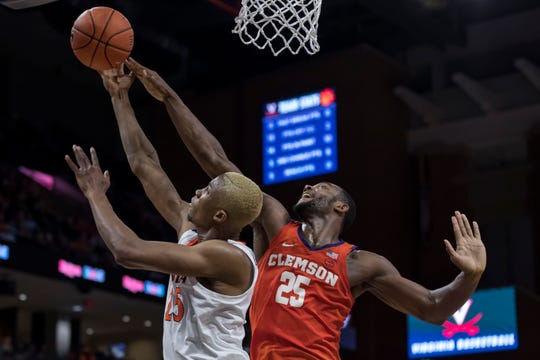 Feb 5, 2020; Charlottesville, Virginia, USA; Clemson Tigers forward Aamir Simms (25) attempts to block the shot of Virginia Cavaliers forward Mamadi Diakite (25) during the second half at John Paul Jones Arena.