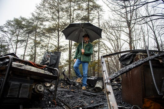 Steven Leiphart of Pickens walks through the charred rubble of his shed after it burned down due to a lightning strike earlier in the morning Thursday, Feb. 6, 2020.