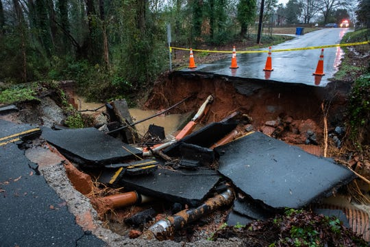 A section of Richbourg Road in Greenville is washed out during a day of heavy rain and flooding Thursday, February 6, 2020.