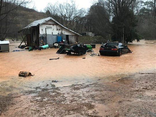 Water floods a backyard off of Bates Crossing Road near Travelers Rest, Thursday, Feb. 6, 2020.