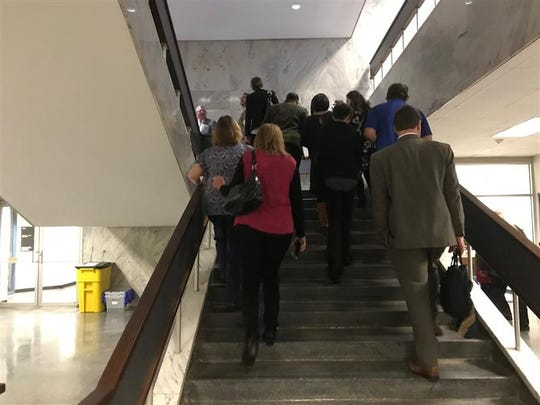 Courthouse workers in Spartanburg return to their stations after seeking shelter in the basement for about 20 minutes, at Spartanburg County Courthouse, Feb. 6, 2020.