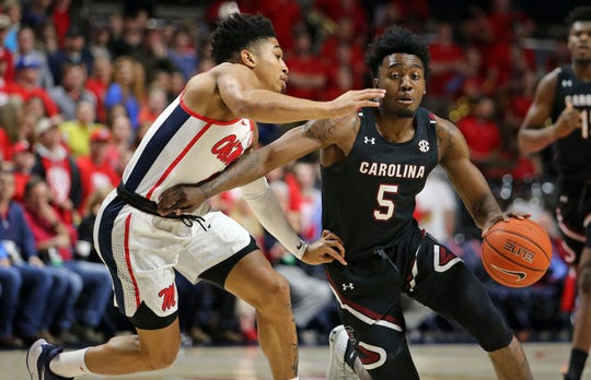 Feb 5, 2020; Oxford, Mississippi, USA; South Carolina Gamecocks guard Jermaine Couisnard (5) dribbles as Mississippi Rebels guard Breein Tyree (4) defends during the first half at The Pavilion at Ole Miss.