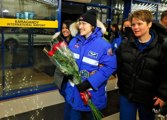 U.S. astronaut Christina Koch arrives in an airport of Karaganda on Thursday after the landing of the Russian Soyuz MS-13 space capsule in the town of Karaganda, Kazakhstan.