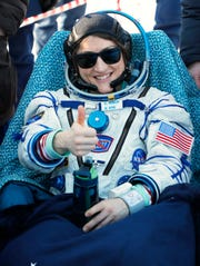 U.S. astronaut Christina Koch gestures shortly after the landing of the Russian Soyuz MS-13 space capsule Thursday about 80 miles south-east of the Kazakh town of Zhezkazgan.