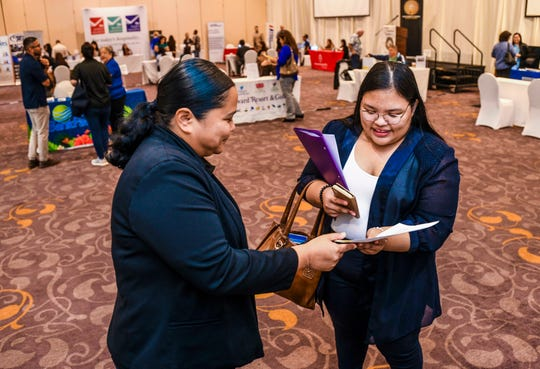 Perla Mendiola, left, LeoPalace Resort human resource specialist, chats with job seeker BobbieJo Taimanglo during the Guam Chamber of Commerce's Chamber Business Women's Network 5th annual Job Fair at the Hyatt Regency Guam on Thursday, Feb. 6, 2020. Taimanglo, a home-schooled senior, says she was hoping to find employment primarily as a photographer or a position in the field of digital media.