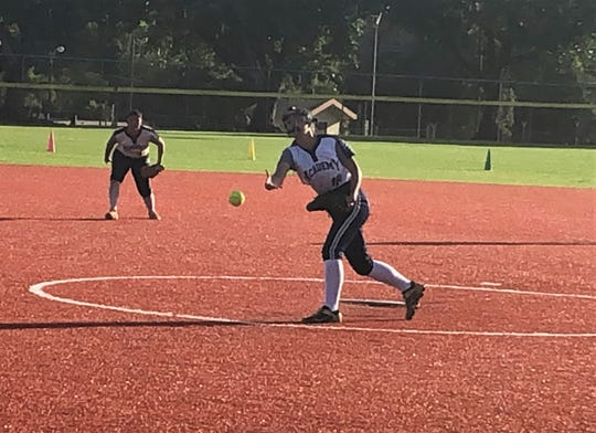 Academy pitcher Isabella Dangan pitches against the Guam High Panthers in Interscholastic Sports Association Girls Softball action Feb. 6 at Guam High. The Cougars won 15-13.