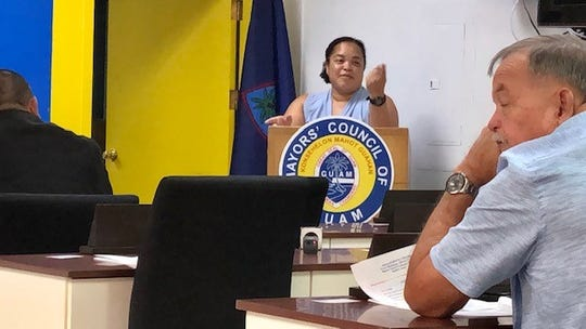 Agriculture Director Chelsea Muna-Brecht gestures as she presents to mayors on Feb. 5 the Department of Agriculture's plan to control Guam's stray dog population, which is estimated to be 60,000.