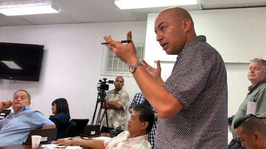 Agriculture Deputy Director Adrian Cruz gestures as he presents to mayors on Feb. 5, 2020 the Department of Agriculture's plan to control Guam's stray dog population, estimated at 60,000.
