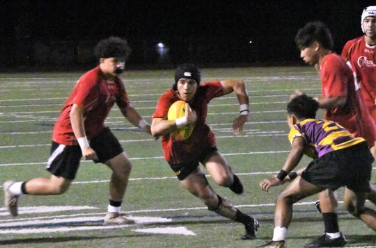 FD Rugby player Kein Artero runs against George Washington during their GRFU/ISA high school rugby match Feb. 5 at Guam High. FD won 35-5.