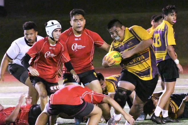 George Washington rugby player Christian Reyes, with ball, runs against Father Duenas during their GRFU/ISA boys rugby match Feb. 5 at Guam High. FD won, 35-5.