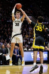 Purdue center Matt Haarms (32) shoots over Iowa forward Cordell Pemsl during the second half of the Boilermakers' 104-68 victory Wednesday at Mackey Arena.