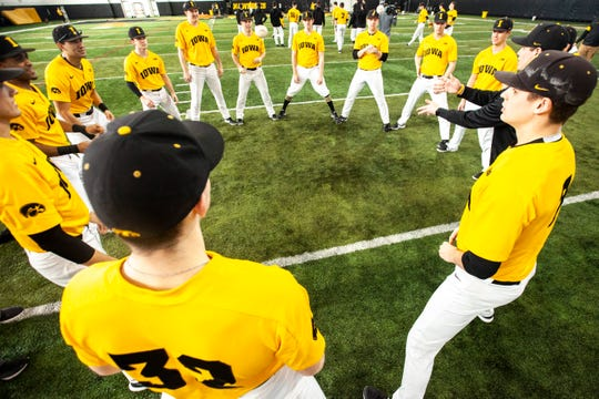 Iowa players keep themselves entertained playing a game during Hawkeye baseball media day, Thursday, Feb. 6, 2020, at the University of Iowa Indoor Practice Facility in Iowa City, Iowa.