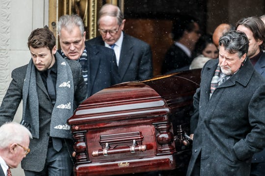 Pallbearers, which included Marco Andretti, left, and Michael Andretti, right, carry the casket of John Andretti out of Saints Peter and Paul Cathedral in Indianapolis, Thursday, Feb. 6, 2020. Andretti lost his fight with cancer on Jan. 30.