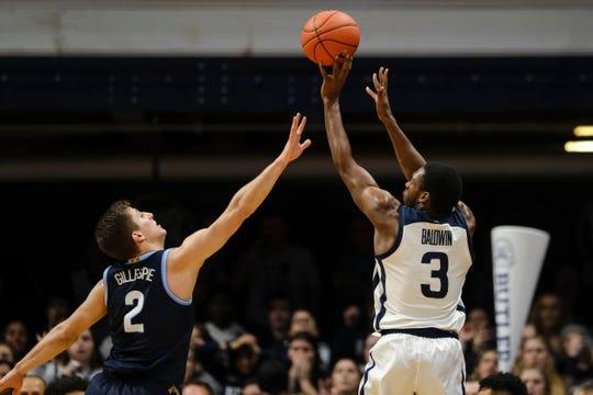 Butler guard Kamar Baldwin (3) shoots the game-winning basket over Villanova guard Collin Gillespie (2) in the second half of an NCAA college basketball game in Indianapolis, Wednesday, Feb. 5, 2020. Butler won 79-76.