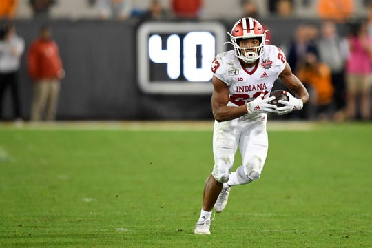 Jan 2, 2020; Jacksonville, Florida, USA; Indiana Hoosiers running back Ronnie Walker Jr. (23) runs with the ball during the fourth quarter against the Tennessee Volunteers at TIAA Bank Field.