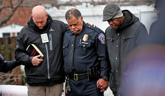 FOP President Richard Snyder, IMPD Chief Randal Taylor, and Rev. Charles Harrison join police, pastors, and the community in prayer during a prayer vigil in the 4100 block of Shady Oak Dr., Thursday, Feb. 6 2020. Four people were fatally shot in an apartment in this Carriage House East, Wednesday night, Feb. 5, 2020.