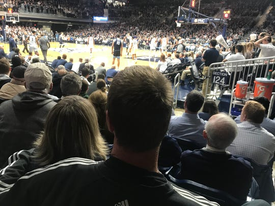 Rik Smits watches his son, Derrik, on the court during the Butler-Villanova game Wednesday, Feb. 5, 2020.