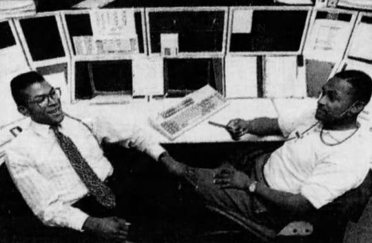 Elmer Akers II (left) speaks to fellow IPD patrolman Bruce Henry while fielding 911 calls in 1992.