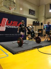 """A determined Linda K. Smith of Iowa City approaches the barbell for her record-setting deadlift during USAPL state powerlifting championships in Des Moines on Jan. 25.  She now owns the national record in her class of this powerlifting federation at 333 pounds. Smith turned 55 the next day and called it """"a great birthday present."""""""