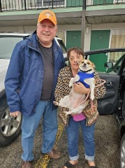 Volunteer driver Rob Beasenburg poses with Julie Hubbard and her dog Lady in Jackson, Tenn. before they start the nearly 600-mile trip to Hubbard's home in Texas.