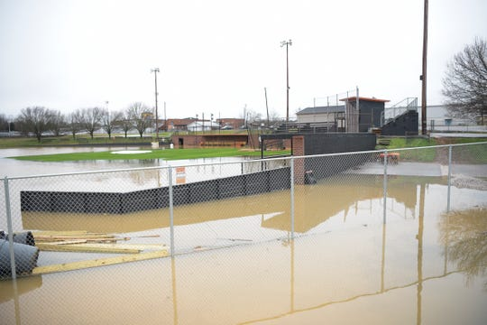 The Powell High School baseball field, shown Thursday, flooded for the second February in a row.