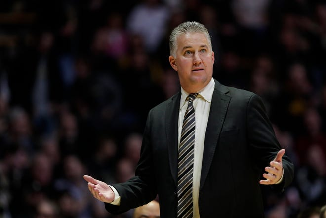 Purdue head coach Matt Painter gestures during the first half of an NCAA college basketball game against Iowa in West Lafayette, Ind., Wednesday, Feb. 5, 2020. (AP Photo/Michael Conroy)
