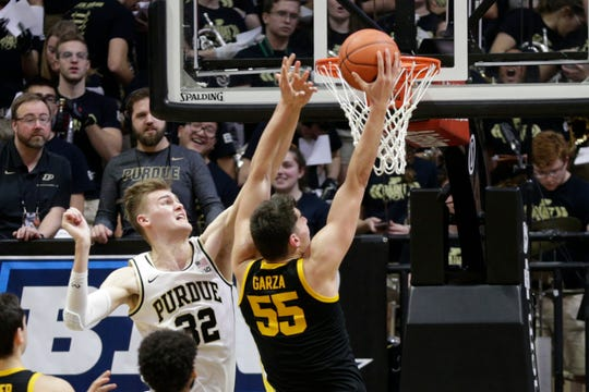 Purdue center Matt Haarms (32) goes up to attempt to block Iowa center Luka Garza (55) during the second half of a NCAA men's basketball game, Wednesday, Feb. 5, 2020 at Mackey Arena in West Lafayette.