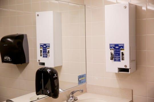 A menstrual product dispenser inside a women's restroom in Purdue University's Stewart Center, Thursday, Feb. 6, 2020, in West Lafayette.