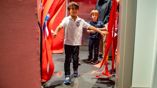 """Episcopal School of Acadiana pre-K student Arman Ehsan walks through the """"stomach"""" to the """"small intestine"""" during an interactive tour of the digestive system put on by fifth-graders Thursday, Feb. 6, 2020."""