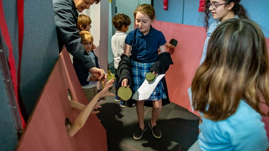 Scout Helveston, a fifth-grader at Episcopal School of Acadiana, shows pre-K students what happens inside of the small intestine during an interactive tour of the digestive system Thursday, Feb. 6, 2020.