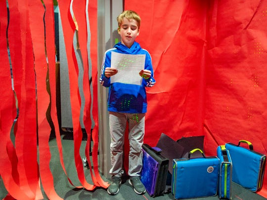 Episcopal School of Acadiana fifth-grader Thomas Breaux reads about what the stomach does Thursday, Feb. 6, 2020.