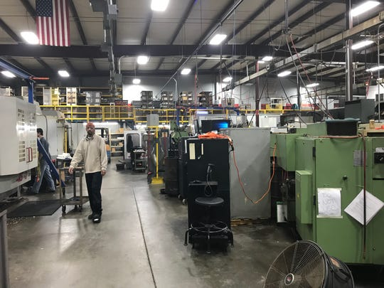 Southeastern Machining & Field Services employees work recently on one of the company's production floors.