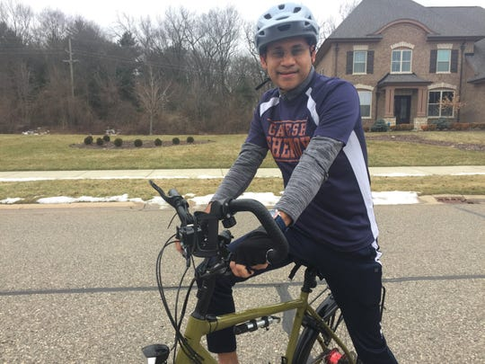 Ganesh Shenoy rides his bike around his Green Oak Township neighborhood, Tuesday, Jan. 4, 2020, to train for a 1,000-mile bike ride for charity.