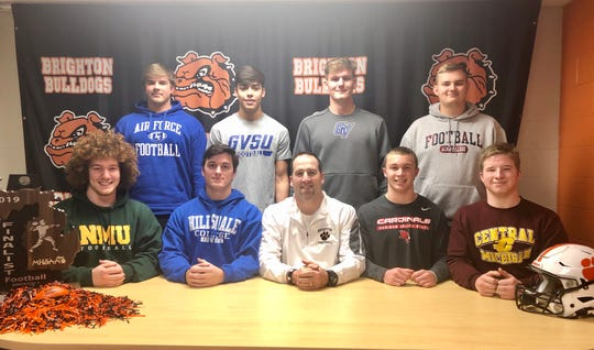 Brighton had eight football players sign with colleges on Wednesday, Feb. 5, 2020. Front row, from left, are Nate Kwapisz, Zach Pardonnet, coach Brian Lemons, Colby Newburg and Cole Riddle. Back row, from left, are Nate Hoffman, Ruben Salinas, Luke Stanton and Jack Cataldo.