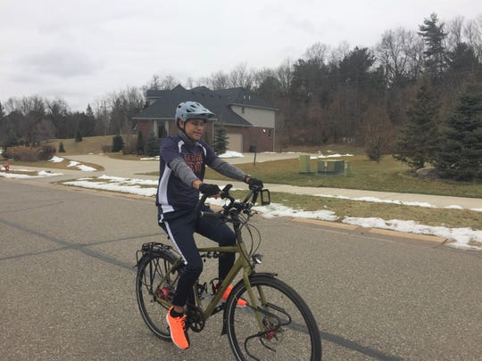 Ganesh Shenoy trains for a 1,000-mile bike ride for charity in his Green Oak Township neighborhood Tuesday, Jan. 4, 2020.
