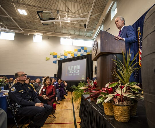 Louisville Police Chief Steve Conrad, left, listens as Mayor Greg Fischer delivered his annual State of the City address from the Republic Bank Foundation YMCA in downtown Louisville on Thursday, Feb. 6, 2020.