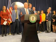 State Rep. Adam Koenig (podium), R-Erlanger, spoke in favor of his bill to legalize sports betting at a press conference with Kentucky Gov. Andy Beshear on Thursday.