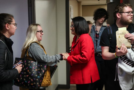 U of L President Neeli Bendapudi greets students on Thursday after addressing concerns that a student distributed anti-gay literature at a LGBTQ class.