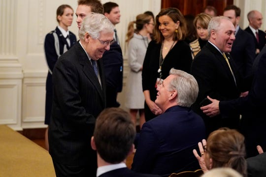Senate Majority Leader Mitch McConnell, R-Ky., left, talks with House Minority Leader Kevin McCarthy, R-Calif., as they arrive to hear President Donald Trump speak in the White House on Thursday.