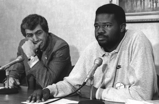 Student spokesperson Darius Peyton, right, and then-MSU President John DiBiaggio talk to reporters after a students and administration negotiation session as students  sit in at the Administration Building in May 1989. Students sat in at the building for over a week.