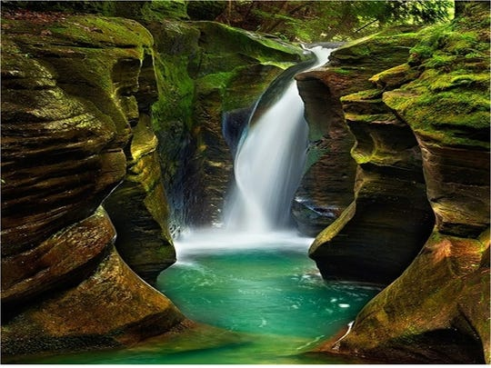 Hocking Hills offers many outdoor activities like hiking to Corkscrew Falls.