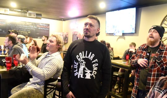 Dustin Parrella watches with friends and family Wednesday night as his episode of Forged in Fire was aired at The Local at 97 in Lexington.