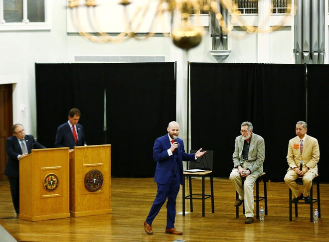 Former Ashland GOP Chairman Bob DeSanto, far left, and former Congressman Jim Renacci serve as moderators as Republican primary candidates for Senate District 22 Cory Branham, Tim Hoven and Ron Falconi participate in the debate at Ashland University's Jack and Deb Miller Chapel Wednesday, February 5, 2020. Noelle Bye, Times-Gazette.com
