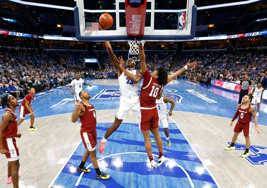 Memphis Tigers center Malcolm Dandridge lays the ball up past Temple Owls forward Jake Forrester during their game at the FedExForum on Wednesday, Feb. 5, 2020.