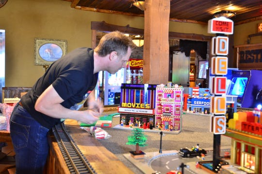 Paul Hetherington spent three months building the Wisconsin Dells-themed Lego village on display at Buffalo Phil's Pizza & Grille.
