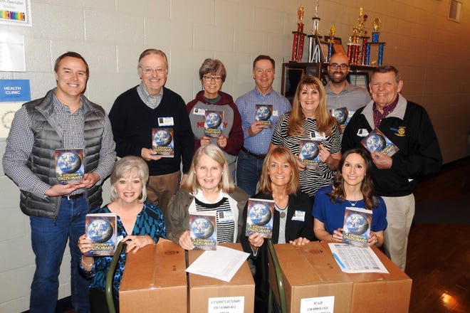 Every year, the Rotary Club of Mountain Home delivers more than 400 dictionaries to area third-grade students in Cotter, Norfork, Mountain Home, and Calico Rock. The books are an encyclopedia of information about the U.S. government, the individual states, braille and sign language, as well as 372 pages of definitions and pronunciations. Projects like this one are made possible by the community's support of the annual Rotary Pancake Day. Pictured above are (back row, fron left) Dictionary Chairman Jay Chafin, Jack Clayton, Renae Schocke, Mark Hopper, Kriss Yunker, Wes Wood, Larry Nelson, (front row, from left) Brenda Nelson, Marilyn Loveless, Susan Stockton, and Heather Hindricks.